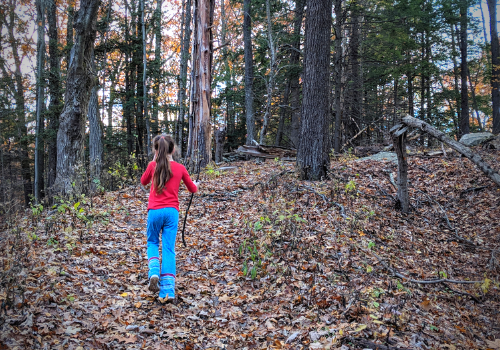 girl hiking in woods