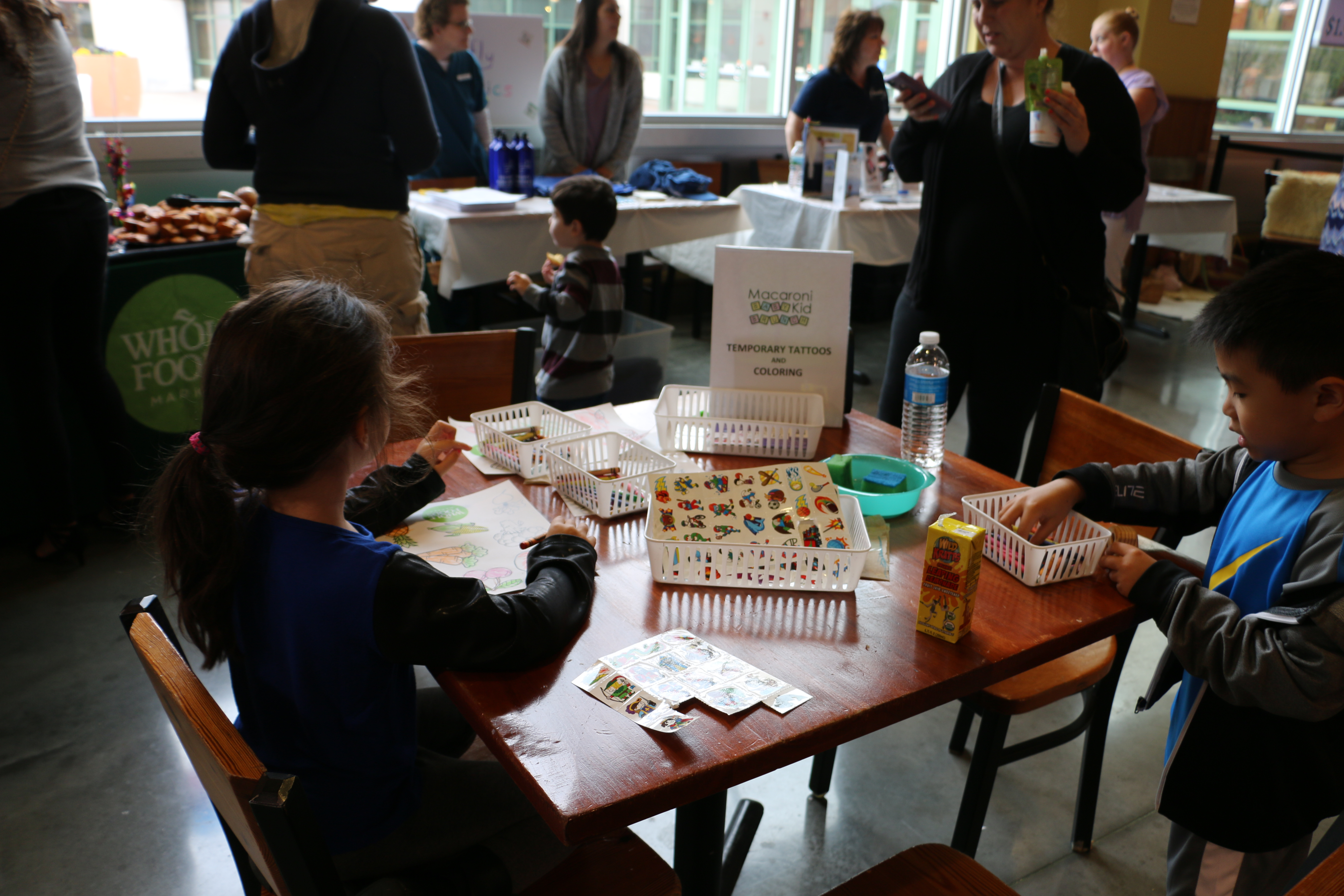 Kids Kept Busy With A Macaroni Kid Activity Table Of Coloring Sheets And Temporary Tattoos