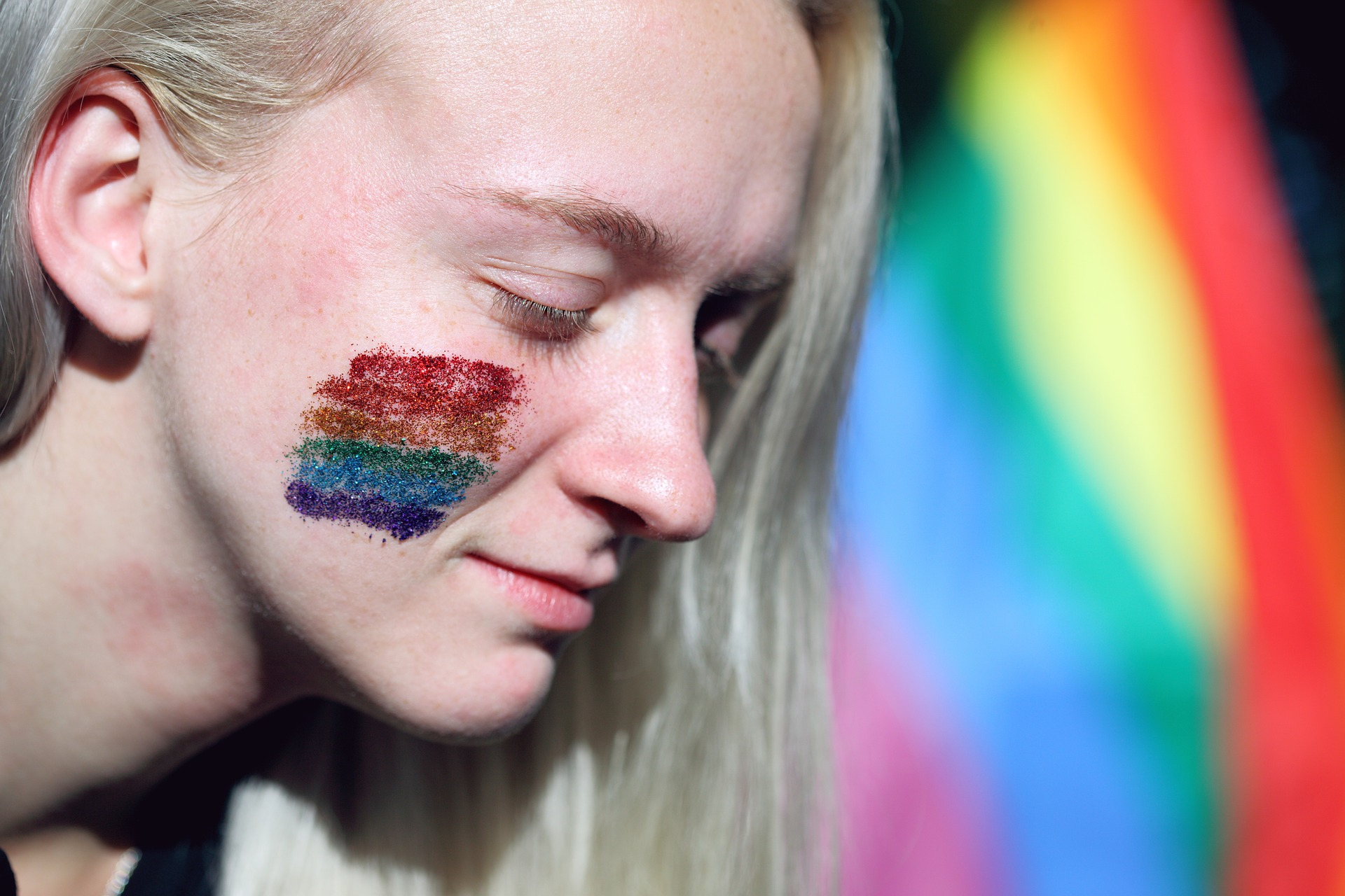 woman with rainbow temporary tattoo on face