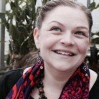 Head shot of Mrs. Candice Holsinger Smiling