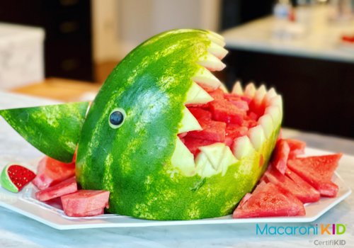 a watermelon carved into a shark figure