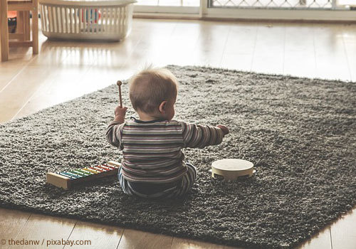 Baby playing with musical instruments