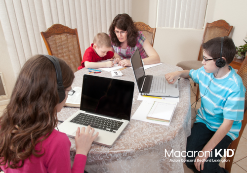 Family with laptops at a table