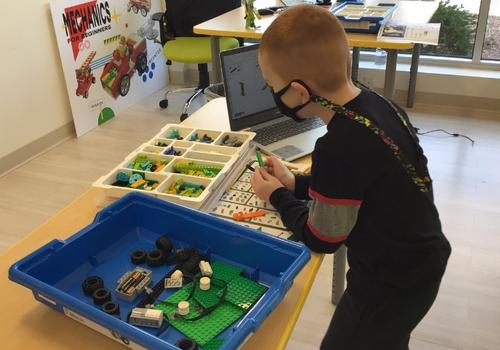 Boy assembling LEGOs