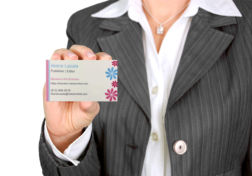 Business Woman holding out a business card.