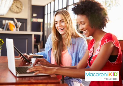 Two women at a computer: Become a Macaroni KID publisher today!