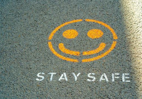 Stay Safe painted on ground