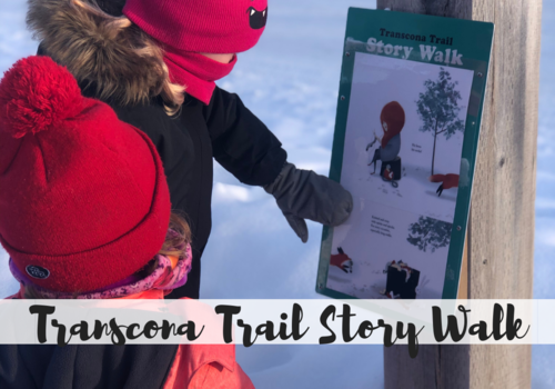 kids reading story outside posted along a trail