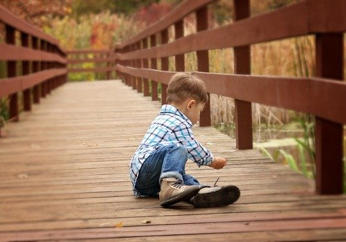 Young boy sitting on a dock
