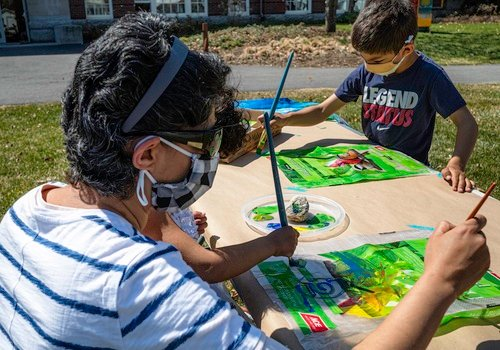 Families painting outside