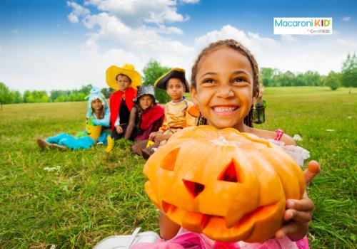 Girl Holds Halloween Pumpkin