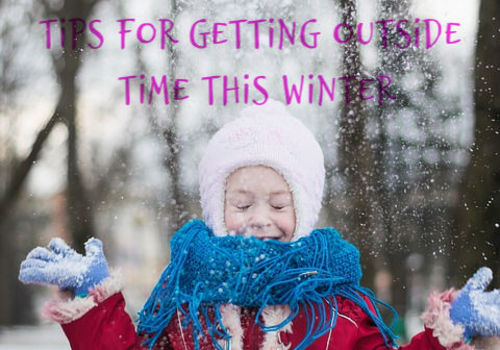 image of girl playing with snow and text saying get out there tips for getting outside this winter