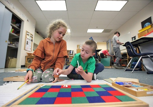 Two children working together at school