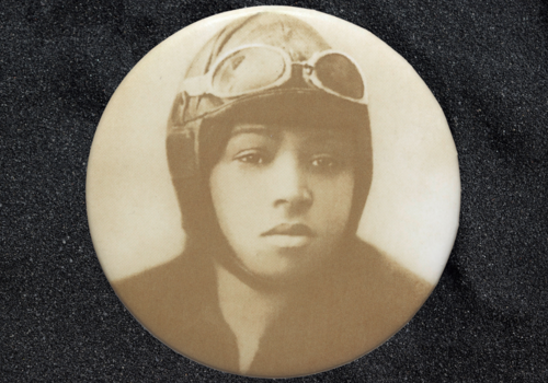 Pinback button featuring a portrait of Bessie Coleman