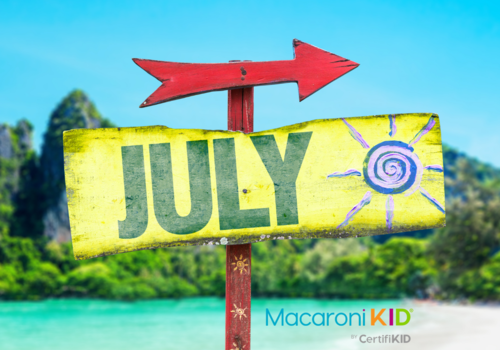 July sign with beach in background