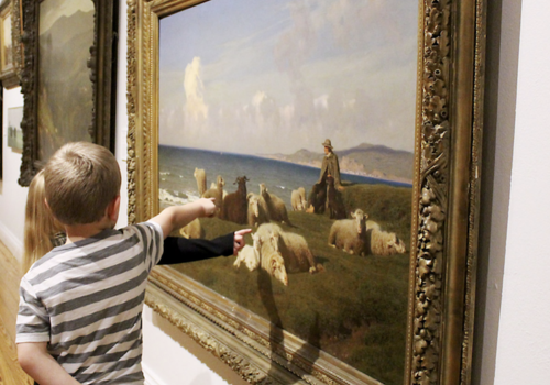 children in gallery at museum pointing out sheep in painting