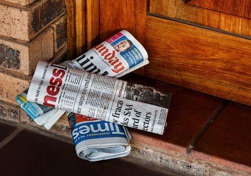 Newspapers at door