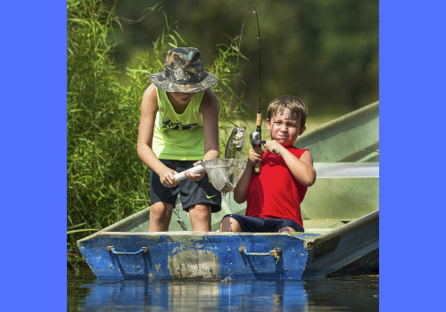 Free fishing day for Alabama is June 13th, 2020, photo showing two kids fishing in a blue boat