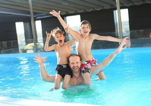 Dad with kids in pool
