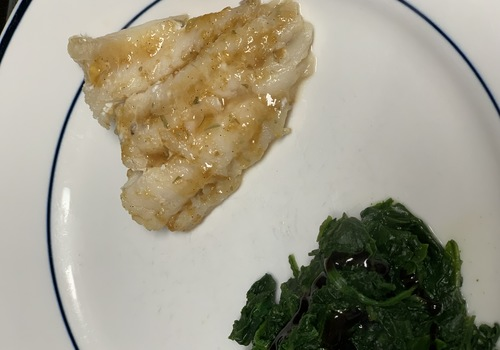 plate of fish and spinach