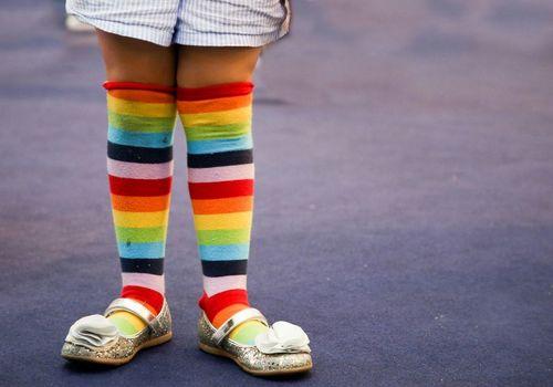 Rainbow socks on little kid legs