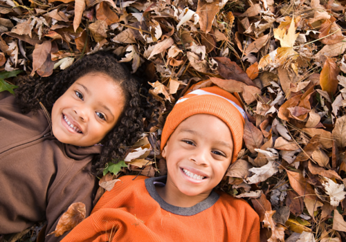 Kids in fall leaves