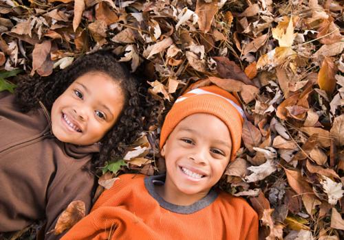 Kids in fall leaves