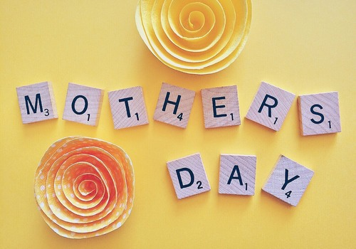 Scrabble Tiles spelling Mother's Day - yellow background