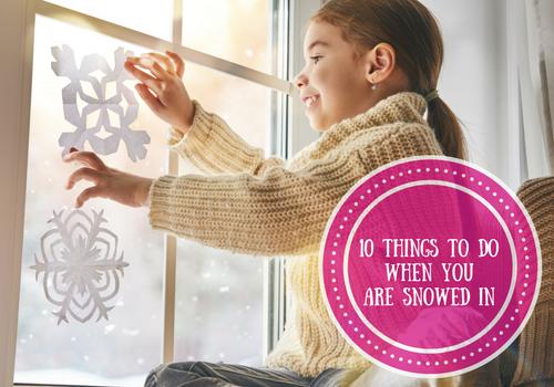 Girl making paper snowflakes