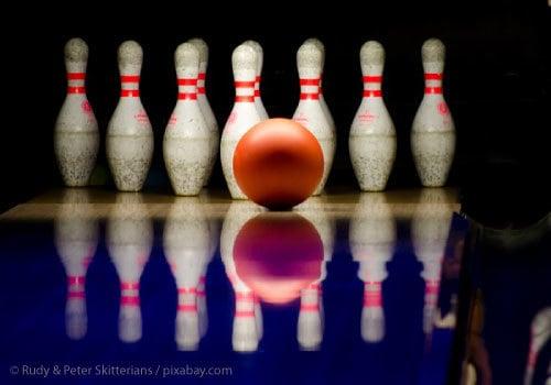 Bowling Ball about to strike bowling pins