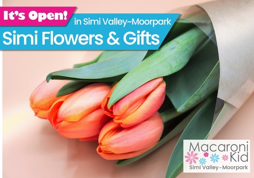 It's Open in Simi Valley and Moorpark! Simi Flowers and Gifts. Image: bouquet of orange tulips rolled up in brown paper