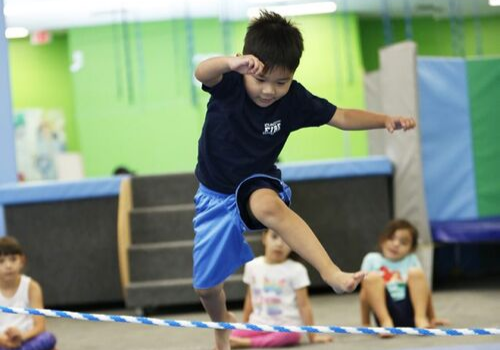 Boy leaping at My Gym fitness center on Boston's South Shore