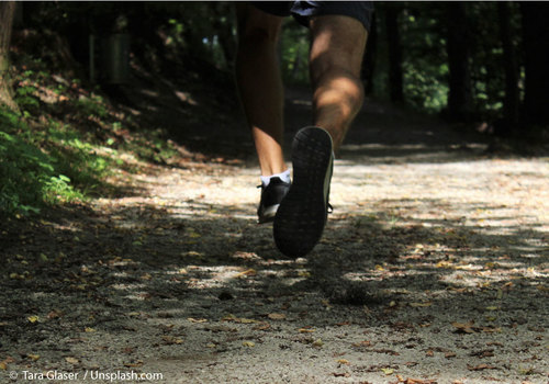 Feet of runner on a trail