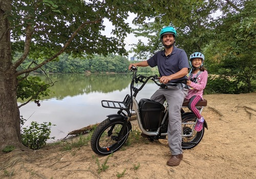 Dad and daughter on bike