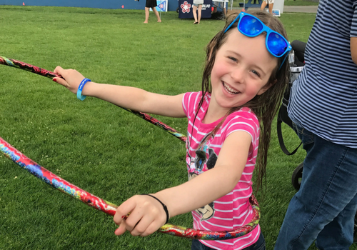 Girl with hula hoop at Rockland Day