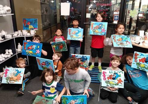 A group of children showing their painting at Serendipity Ceramics and Painting Studio on the Westbank of New Orleans