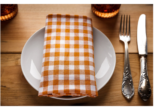 Dinner plate with napkin and silverware