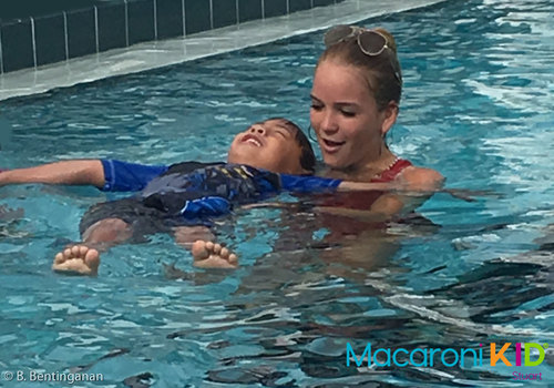 Young boy taking swimming lessons