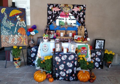 Alter decorated with sugar skulls and marigolds at Presidio Museum