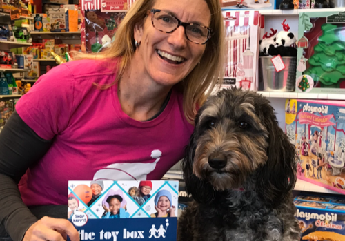 The Toy Box toystore owner Julie and store mascot Roxie