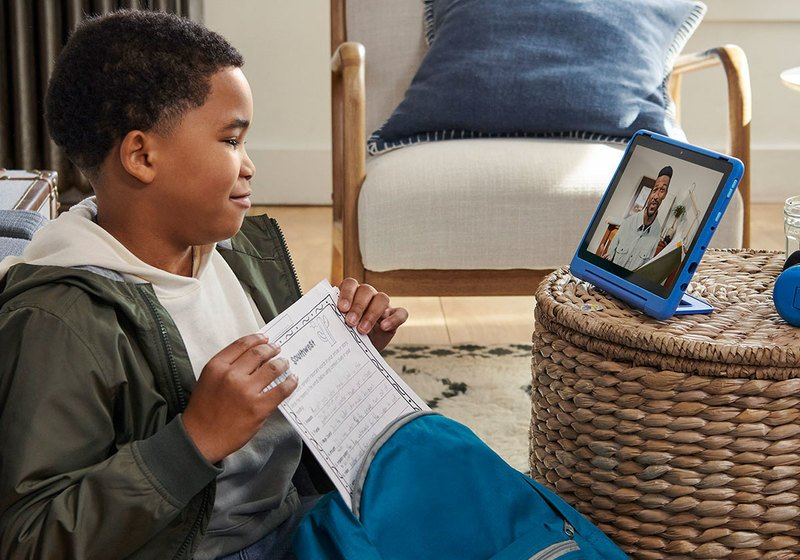 boy talking to dad on his Amazon Fire Kids Pro tablet