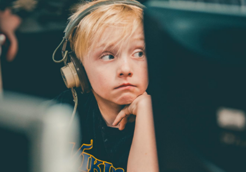 tired boy on computer