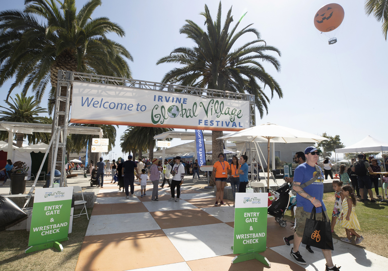welcome to irvine global fest sign people entering