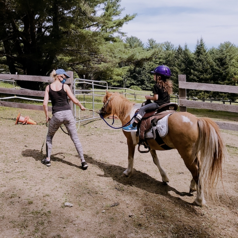 Berkshire HorseWorks instructor horse child in rink