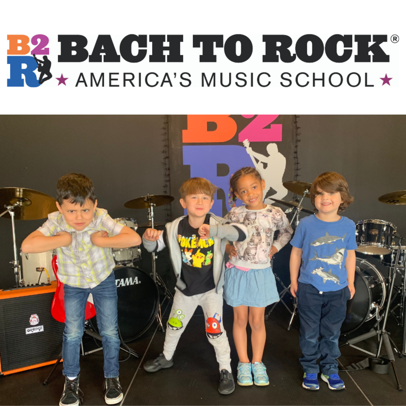 Four Kids on stage with music gear