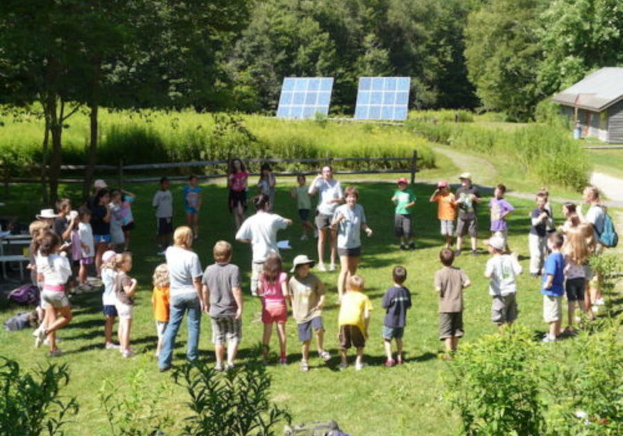 child campers in circle for game at pleasant valley wildlife camp