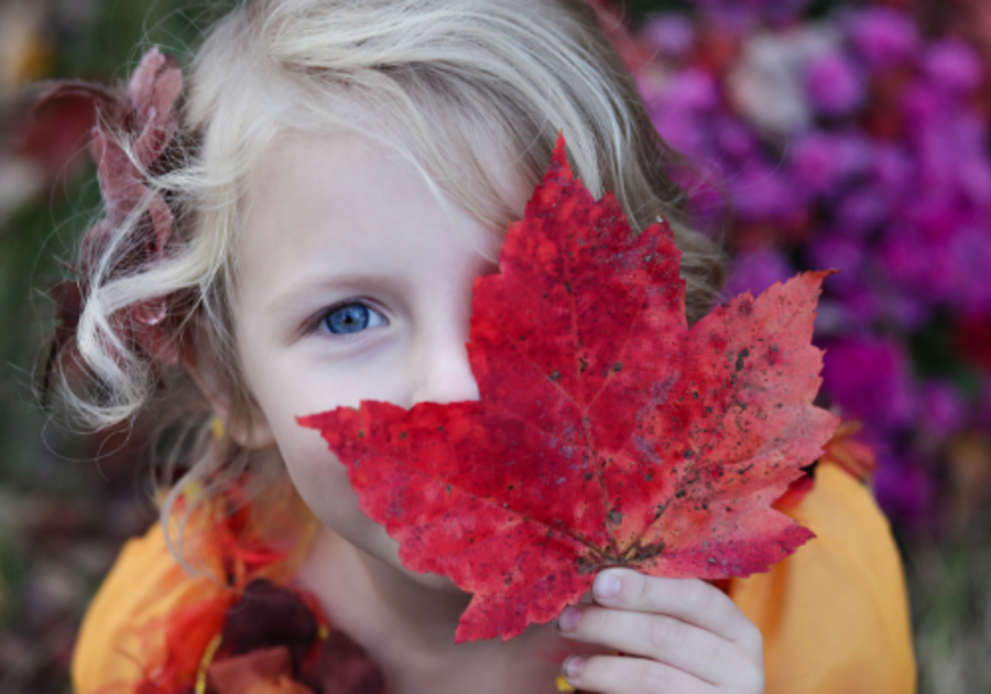 Girl in fall with leaf