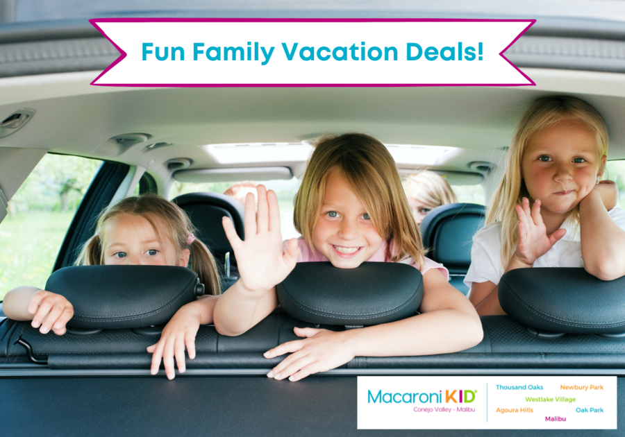Family Travelling by Car with three girls looking out the back