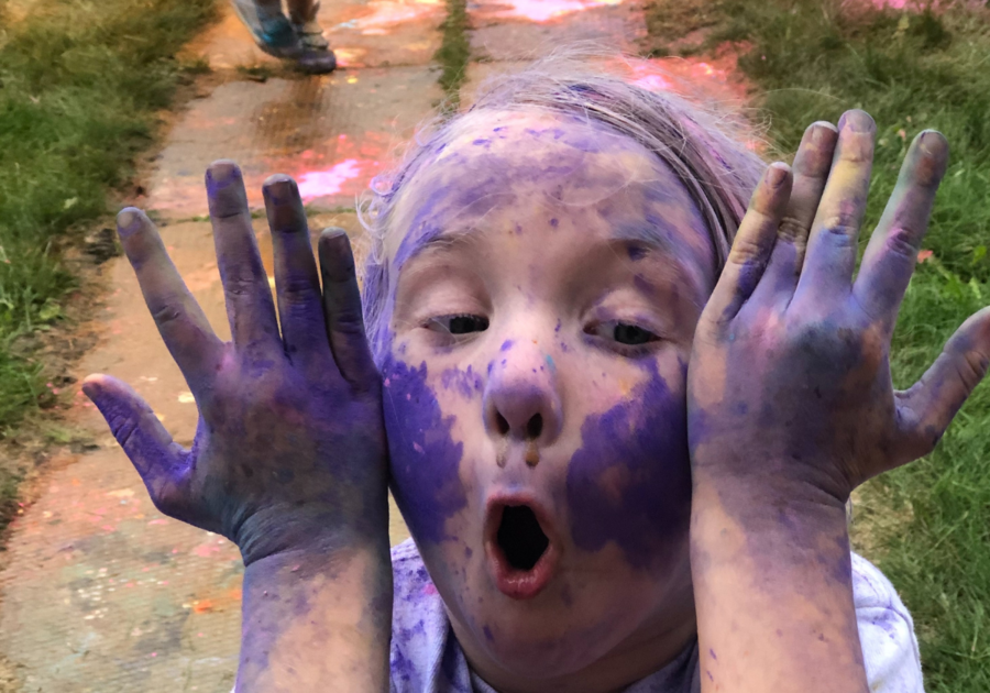child covered in colour powders