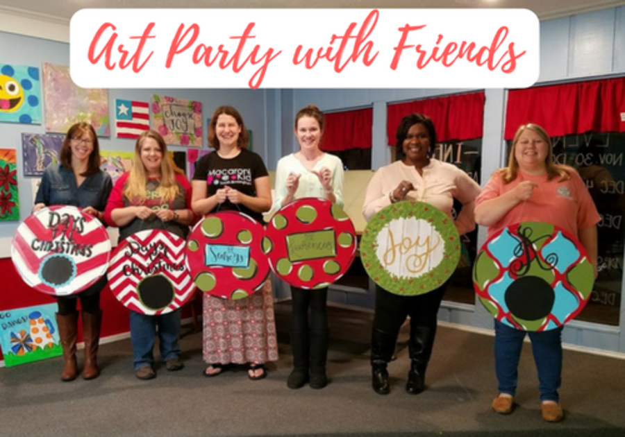 Group of women pose with completed art party projects